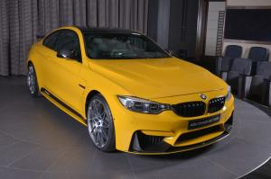 BMW M4 Coupe in Speed Yellow M Performance by Abu Dhabi Motors