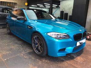 BMW M5 Gloss Atomic Teal by Impressive Wrap
